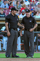 Home plate umpire Alex Nash and first base umpire Jake Botek talk between innings during a Midwest League game between the Clinton LumberKings and the Wisconsin Timber Rattlers on June 29, 2018 at Fox Cities Stadium in Appleton, Wisconsin. Clinton defeated Wisconsin 9-7. (Brad Krause/Four Seam Images)