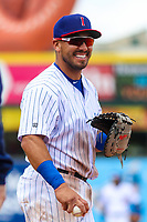 Iowa Cubs first baseman Phillip Evans (18) laughs with opposing players between innings during a Pacific Coast League game against the San Antonio Missions on May 2, 2019 at Principal Park in Des Moines, Iowa. Iowa defeated San Antonio 8-6. (Brad Krause/Four Seam Images)
