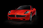 Red 2018 Karma Revero plug-in hybrid electric luxury sports sedan, successor of Fisker Karma electric car. Isolated on black background with clipping path. Image © MaximImages, License at https://www.maximimages.com