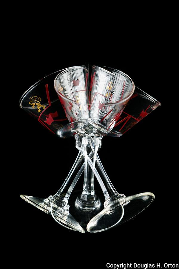 Stemmed glass, wine glass, apertif glass, multiple exposure, black background, unique view