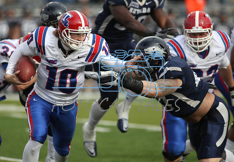Louisiana Tech quarterback Colby Cameron (10) scrambles from Nevada defender Brett Roy (47) during the first quarter of an NCAA football game Saturday, Nov. 19, 2011, in Reno, Nev. (AP Photo/Cathleen Allison)