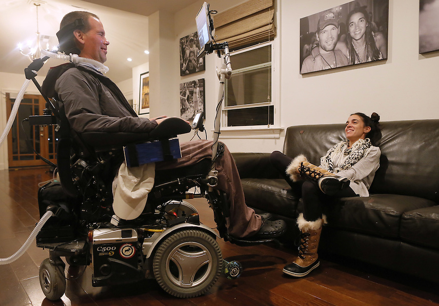 In this Monday, Jan. 18, 2016 photo, former New Orleans Saints NFL football player Steve Gleason and his wife, Michel, relax in their home after an interview in New Orleans. (AP Photo/Jonathan Bachman)