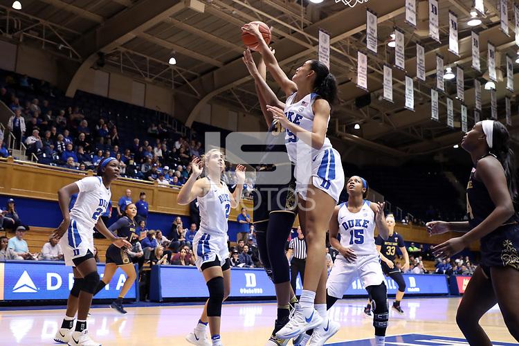 DURHAM, NC - JANUARY 16: Jade Williams #25 of Duke University blocks a shot by Mikayla Vaughn #30 of Notre Dame University during a game between Notre Dame and Duke at Cameron Indoor Stadium on January 16, 2020 in Durham, North Carolina.