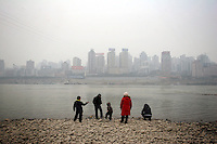 CHINA. Sichuan Province. Chongqing. A family stand on the banks of the Yangtze river which is at its lowest level for 150 years as a result of a nationwide drought. Chongqing is a city of over 3,000,000 people, famed for being the capital of China between 1938 and 1946 during World War II. It is situated on the banks of the Yangtze river, China's longest river and the third longest in the world. Originating in Tibet, the river flows for 3,964 miles (6,380km) through central China into the East China Sea at Shanghai.  2008.