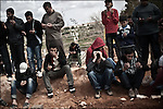 © Remi OCHLIK/IP3 -   Benghazi  March 21, 2011 - Funerals in the cimetery of Benghazi..Libyan men morn the dead in the morgue of the Benghazi hospital - At least 84 people, most of them are civilians , and had been killed in the Ghadafi air strike the day before.