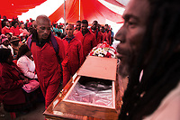 Funeral of Kervin Arthur Woods (46), a member of the Red Ants. He was killed during an eviction near Lenasia, South of Johannesburg. During the eviction, members of the community opened fire on the Red Ants. Woods was shot and wounded and then stabbed multiple times.<br />The Red Ants are a controversial private security company often hired to clear squatters from land and so-called 'hijacked' properties.
