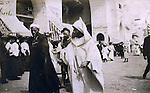 St Louis MO:  A view of Moroccan Merchants taking a break and walking down the pike from their exhibits