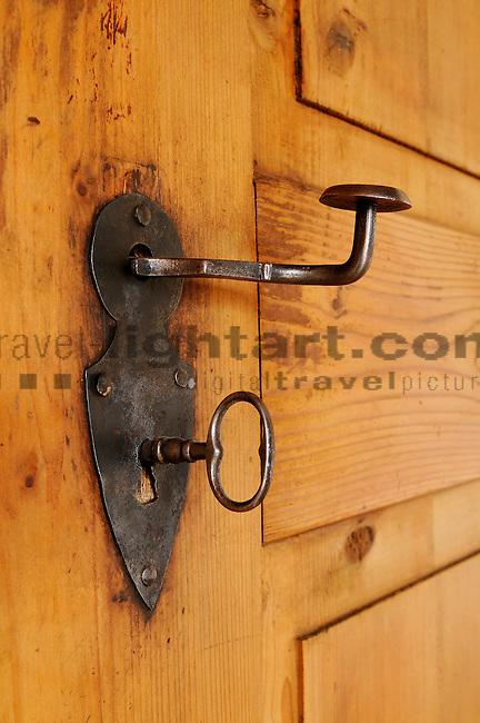 Key in lock in an old house, Malans, Grisons, Switzerland. Schlüssel in Türschloss in altem Haus in Malans, Graubünden, Schweiz.