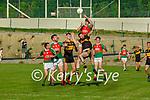 Kieran Murphy Kilcummin rises above Brendan Falvey Dr Crokes during their Div 1A SFL game in Kilcummin on Friday