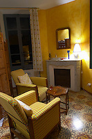 Corner with chairs. Fireplace. Guest room, hotel, interior. Domaine Grand Guilhem. In Cascastel-des-Corbieres. Fitou. Languedoc. France. Europe.