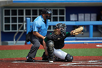 Catcher Trey Way (2) of Uwharrie Charter Academy in Asheboro, NC frames a pitch as home plate umpire Brett Stowe looks on during the Atlantic Coast Prospect Showcase hosted by Perfect Game at Truist Point on August 23, 2020 in High Point, NC. (Brian Westerholt/Four Seam Images)
