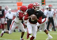 Arkansas quarterback Malik Hornsby (4) look to pass the ball Saturday, April 3, 2021, during a scrimmage at Razorback Stadium in Fayetteville. Visit nwaonline.com/210404Daily/ for today's photo gallery. <br /> (NWA Democrat-Gazette/Andy Shupe)