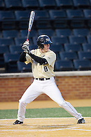 Kevin Conway (8) of the Wake Forest Demon Deacons at bat against the Cincinnati Bearcats at Wake Forest Baseball Park on February 21, 2014 in Winston-Salem, North Carolina.  The Bearcats defeated the Demon Deacons 5-0.  (Brian Westerholt/Four Seam Images)