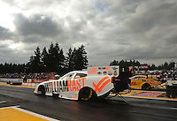 Aug. 5, 2011; Kent, WA, USA; NHRA funny car driver Brian Thiel (near lane) races alongside Jeff Arend during qualifying for the Northwest Nationals at Pacific Raceways. Mandatory Credit: Mark J. Rebilas-