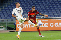 Roma s Lorenzo Pellegrini, right, is challenged by Benevento s Gaetano Letizia during the Serie A soccer match between Roma and Benevento at Rome's Olympic Stadium, October 18, 2020.<br /> UPDATE IMAGES PRESS/Riccardo De Luca