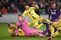 30th May 2021; Auckland, New Zealand;  Ulises Davila jumps over keeper Liam Reddy as the ball goes wide. Wellington Phoenix versus Perth Glory, A-League football at Eden Park.