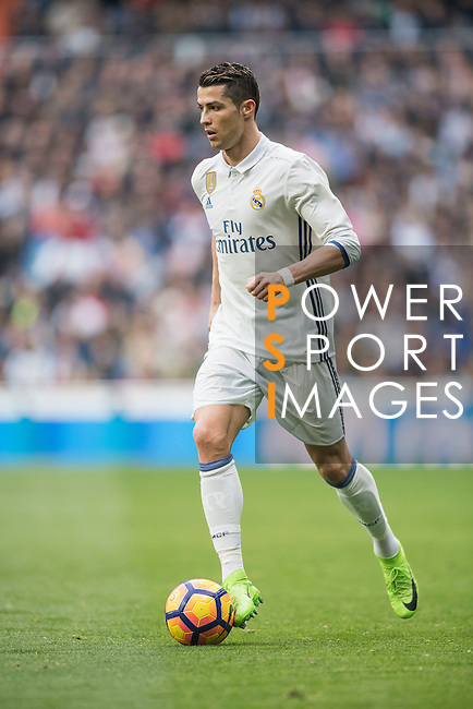 Cristiano Ronaldo of Real Madrid  runs with the balls during the match Real Madrid vs RCD Espanyol, a La Liga match at the Santiago Bernabeu Stadium on 18 February 2017 in Madrid, Spain. Photo by Diego Gonzalez Souto / Power Sport Images