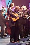 September 26, 2013. Raleigh, North Carolina.<br />  After being inducted the International Bluegrass Music Hall of Fame, Tony Rice, center, played a short set with bluegrass legends such as Sam Bush, Ricky Skaggs and Jerry Douglas.<br />  Bluegrass guitar legend Tony Rice was inducted into the International Bluegrass Music Hall of Fame during the International Bluegrass Music Awards, held in Memorial Hall at the Duke Energy Center for the Performing Arts.