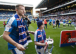 Andy Halliday and Rangers mascot Lee Welsh