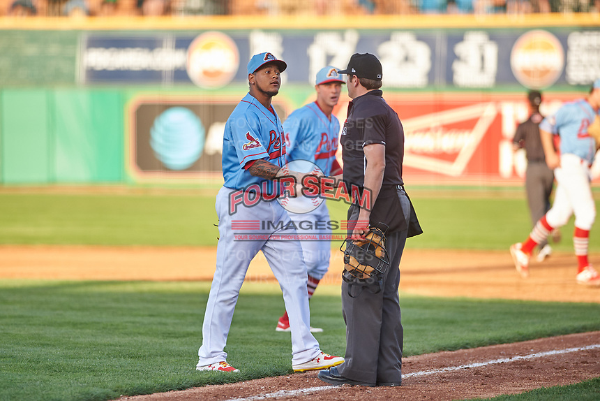 St. Louis Cardinals pitcher Carlos Martinez (18) shakes hands with home plate umpire Jeff Hamann during a rehab appearance during a Midwest League game between the Peoria Chiefs and the Bowling Green Hot Rods at Dozer Park on May 5, 2019 in Peoria, Illinois. Peoria defeated Bowling Green 11-3. (Zachary Lucy/Four Seam Images)