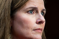 Supreme Court nominee Judge Amy Coney Barrett listens to Democratic Senator from Rhode Island Sheldon Whitehouse (not pictured) as she participates in her confirmation hearing before the Senate Judiciary Committee in the Hart Senate Office Building in Washington, DC, USA, 13 October 2020. US President Donald J. Trump nominated Barrett  to fill the vacancy Justice Ruth Bader Ginsburg left when she passed away on 18 September 2020.<br /> Credit: Jim LoScalzo / Pool via CNP /MediaPunch<br /> CAP/MPI/RS<br /> ©RS/MPI/Capital Pictures