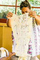 Kapa making on the Big Island: Pomai inspects beaten wauke, which she will felt with another piece to make a larger kapa.