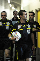 Match officials prepare to take to the field during the A-League elimination final football match between Wellington Phoenix v Sydney FC at Westpac Stadium, Wellington, New Zealand on Friday, 30 March 2012. Photo: Dave Lintott / lintottphoto.co.nz