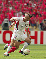 Clint Mathis, sporting a mohawk, scored the USA's only goal. The USA tied South Korea, 1-1, during the FIFA World Cup 2002 in Daegu, Korea.