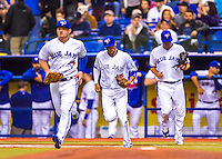 2 April 2016: The Toronto Blue Jays take the field to start a pre-season exhibition game against the Boston Red Sox at Olympic Stadium in Montreal, Quebec, Canada. The Red Sox defeated the Blue Jays 7-4 in the second of two MLB weekend games, which saw a two-game series attendance of 106,102 at the former home on the Montreal Expos. Mandatory Credit: Ed Wolfstein Photo *** RAW (NEF) Image File Available ***