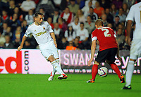 Pictured L-R: Stephen Dobbie of Swansea against Bobby Hassell of Barnsley. Tuesday 28 August 2012<br /> Re: Capital One Cup game, Swansea City FC v Barnsley at the Liberty Stadium, south Wales.