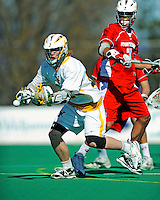 30 April 2011: University of Vermont Catamount attacker A.J. Masson, a Sophomore from Newmarket, Ontario, in action against the Stony Brook Seawolves at Moulton Winder Field in Burlington, Vermont. The Catamounts fell to the visiting Seawolves 12-9 to conclude their America East season. Mandatory Credit: Ed Wolfstein Photo