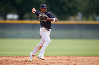 FCL Yankees shortstop Alexander Vargas (14 throws to first base during a game against the FCL Phillies on July 6, 2021 at the Yankees Minor League Complex in Tampa, Florida.  (Mike Janes/Four Seam Images)