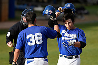 Right fielder John Miller (18) of the Spartanburg Methodist College Pioneers is congratulated by Houston Wright (38) after hitting a home run in Game 2 of a junior college doubleheader against Southeastern Community College on Wednesday, March 28, 2018, at Mooneyham Field in Spartanburg, South Carolina. (Tom Priddy/Four Seam Images)