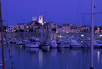 France, Antibes, Cote d' Azur, Provence, Alpes-Maritimes, Europe, Boats docked in Port Vauban Harbor on the Mediterranean Sea in the city of Antibes in the evening.