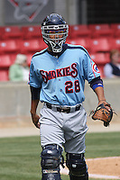 Robinson Chirinos #27 of the Tennessee Smokies coming back to the dugout after warming up a pitcher between innings during a game against the Carolina Mudcats on April 20, 2010 in Zebulon, NC.