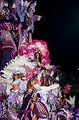 Rio de Janeiro, Brazil. Carnival; sequin and feather costumed women on a float. Sapucai, sambodomo.