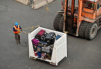 Baggage being loaded onto a cruise ship.