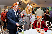 Pictured L-R: Lottery winners Matt Evans and Karen Willett serve guests with drinks. Wednesday 28 November 2018<br /> Re: National Lottery millionaires from south Wales and the south west of England have hosted a glitzy Rat Pack-inspired Christmas party for an older people's music group at The Bear Hotel in Cowbridge, Wales, UK.