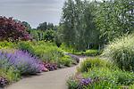 Walkway entering Oregon Gardens.  Oregon Gardens, Silverton, Oregon, USA, an 80 acre botanical garden in the Willamette Valley.  Windy day.  HDR image.