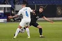 Victor Palsson (Island Iceland) trennt Leon Goretzka (Deutschland Germany) vom Ball- 25.03.2021: WM-Qualifikationsspiel Deutschland gegen Island, Schauinsland Arena Duisburg