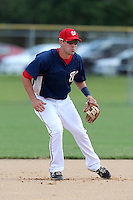 Washington Nationals shortstop Jason Martinson #13 warmus up before an Instructional League game against the national team from Italy at Carl Barger Training Complex on September 28, 2011 in Viera, Florida.  (Mike Janes/Four Seam Images)