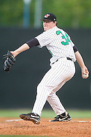 Winston-Salem's Lucas Harrell winds up to deliver a pitch to the plate versus the Frederick Keys at Ernie Shore Field in Winston-Salem, NC, Thursday, June 15, 2006.