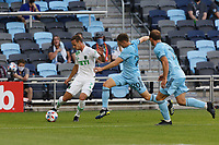 SAINT PAUL, MN - MAY 1: Tomas Pochettino #7 of Austin FC and Wil Trapp #20 of Minnesota United FC battle for the ball during a game between Austin FC and Minnesota United FC at Allianz Field on May 1, 2021 in Saint Paul, Minnesota.