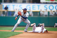 Columbus Clippers second baseman Erik Gonzalez (11) waits for a throw as Danny Santana (9) slides in during a game against the Rochester Red Wings on June 16, 2016 at Frontier Field in Rochester, New York.  Rochester defeated Columbus 6-2.  (Mike Janes/Four Seam Images)