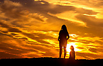 A mother and her daughter watch the Christmas Eve sunset at Shell Point Beach along the Forgotten Coast of the north Florida panhandle.