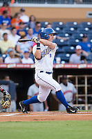 Boog Powell (2) of the Durham Bulls follows through on his swing against the Indianapolis Indians at Durham Bulls Athletic Park on August 4, 2015 in Durham, North Carolina.  The Indians defeated the Bulls 5-1.  (Brian Westerholt/Four Seam Images)
