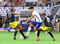 DALLAS, TX - JULY 25: Nicholas Gioacchini #8 of the United States battles Damion Lowe #17 and Oniel Fisher #8 of Jamaica for the ball during a game between Jamaica and USMNT at AT&T Stadium on July 25, 2021 in Dallas, Texas.