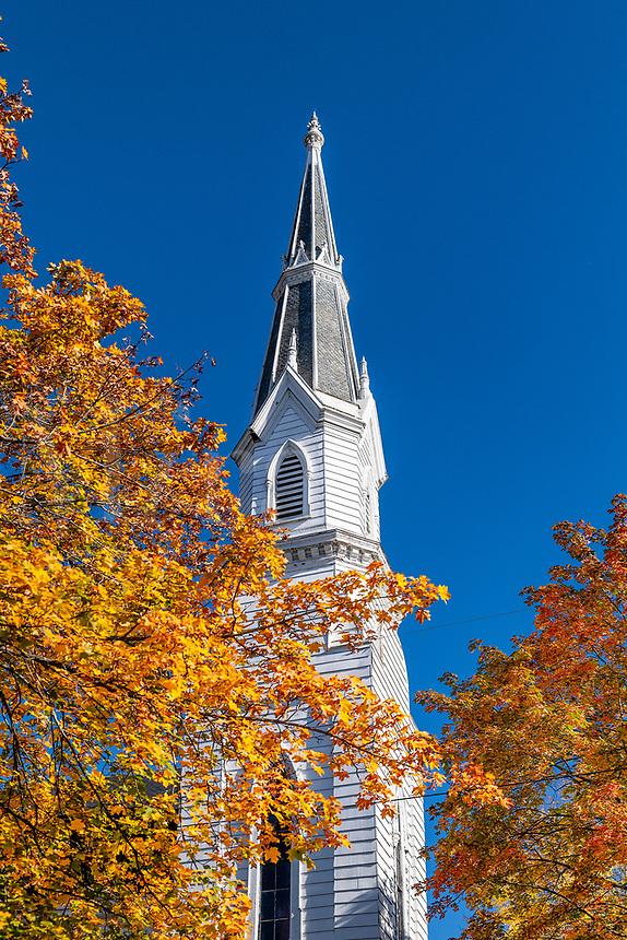 Charming church steeple amist autumn foliage, Montpellier, Vermont, USA.
