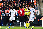 Eric Bailly of Manchester United (C) gets a yellow card from FIFA Referee Georgi Kabakov of Bulgaria (R) during the UEFA Champions League 2018-19 match between Valencia CF and Manchester United at Estadio de Mestalla on December 12 2018 in Valencia, Spain. Photo by Maria Jose Segovia Carmona / Power Sport Images