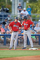 Fort Myers Miracle manager Toby Gardenhire (33) talks with Trevor Larnach (9) during a Florida State League game against the Charlotte Stone Crabs on April 6, 2019 at Charlotte Sports Park in Port Charlotte, Florida.  Fort Myers defeated Charlotte 7-4.  (Mike Janes/Four Seam Images)